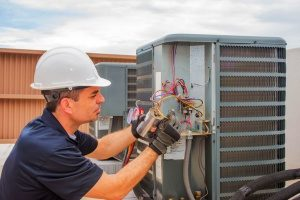 HVAC contractor in Gaithersburg, MD performing routine HVAC maintenance