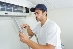new hvac contractor doing his first air conditioning maintenance work