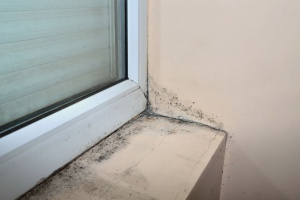 old and cracking window letting in air causing the need for HVAC maintenance
