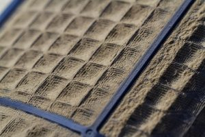 HVAC filter that is extremely dirty and filled with pollen