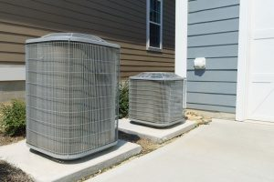 two outdoor HVAC units experiencing one of the most common HVAC problems faced daily by homeowners