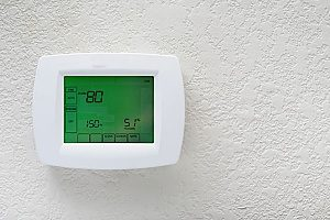 a picture of a thermostat that also doubles as a humidistat showing a really high percentage of humidity in the air which affects the indoor air quality of the home