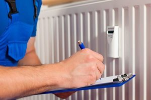 HVAC Contractor checking a homeowner's heating system