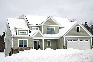 a home in Maryland that is covered in snow during the winter and thankfully the homeowners received a new heating system from Maryland HVAC contractors before the snow storm
