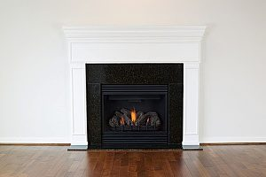 a natural gas fireplace in a Maryland home that does not need another heating system since the fireplace puts out enough warmth into the air