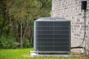 an energy efficient hvac system in the backyard of a home