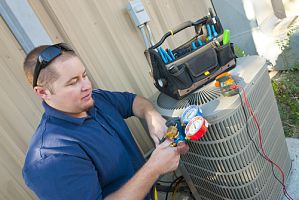 hvac technician installing an new energy efficient HVAC system