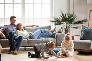 family sitting inside enjoying their new central air system