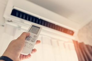 person using air conditioning system in home