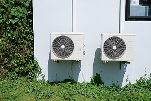 commercial HVAC compressors helping to cool a building