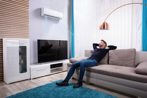 man enjoying his air conditioner setting