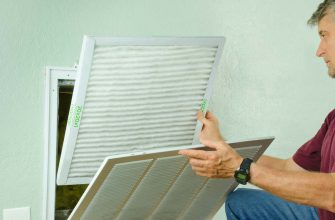 Man inserting proper size air filter
