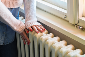 Hand on radiator to emulate the longevity of furnace