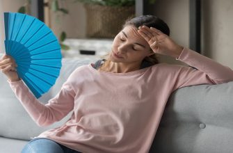 woman fanning herself because of heat