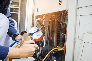 an HVAC professional repairing a geothermal installation at a home
