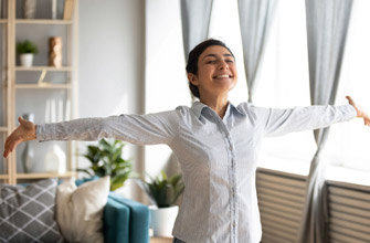 happy woman enjoying benefits of new efficient hvac system