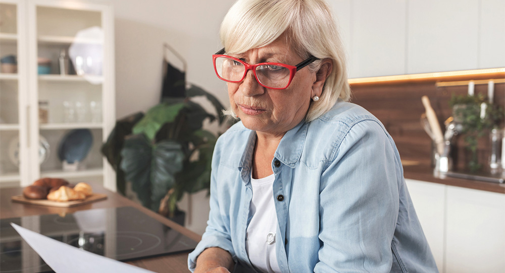Woman reviewing high electric bill time to replace hvac